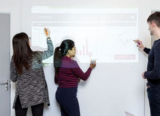 employees draw on smart whiteboard wallpaper low sheen while projecting
