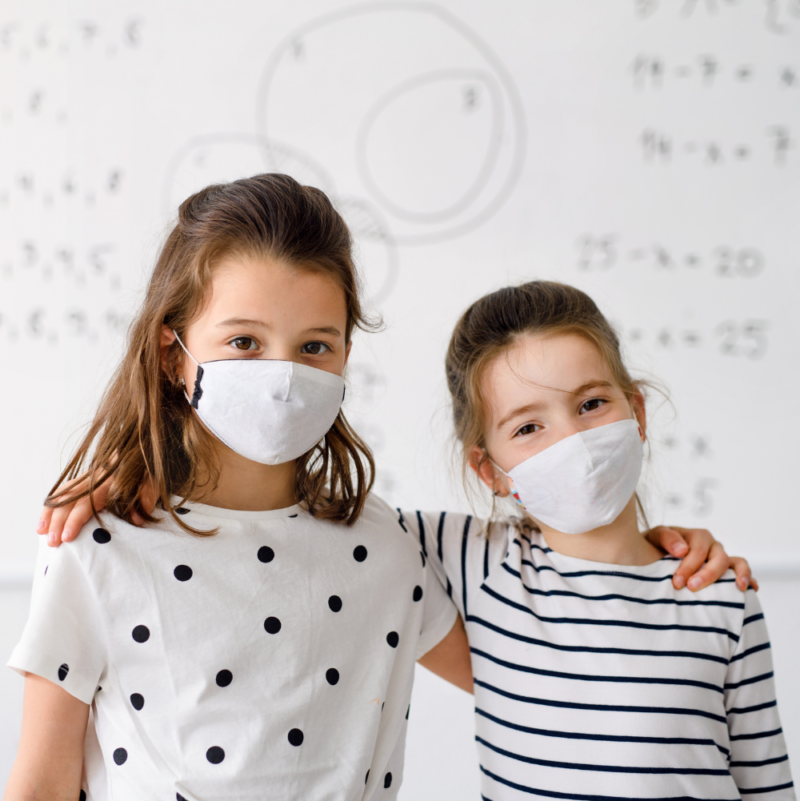 two-children-standing-infront-of-Smart -Antimicrobial-whiteboard-paint