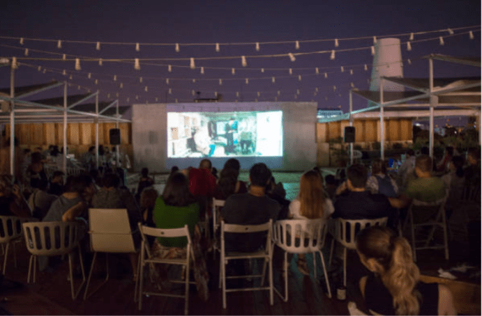 smart-projector-paint-pro-screen-used-outdoors-at-night